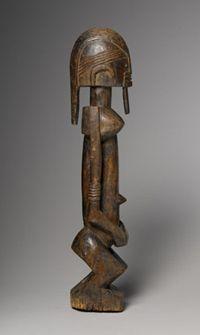Statuette féminine, bois.