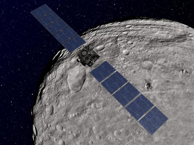 Vue d'artiste de la sonde Dawn, en orbite autour de Vesta