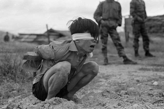 A Viet Cong prisoner is interrogated in Thuong Duc, 25 km west of Da Nang