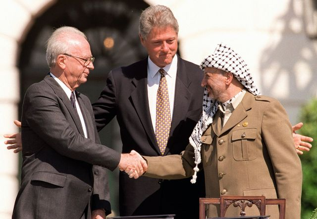 Yitzhak Rabin with President Clinton and Yasser Arafat during the signing of the Oslo I Accord in 1993