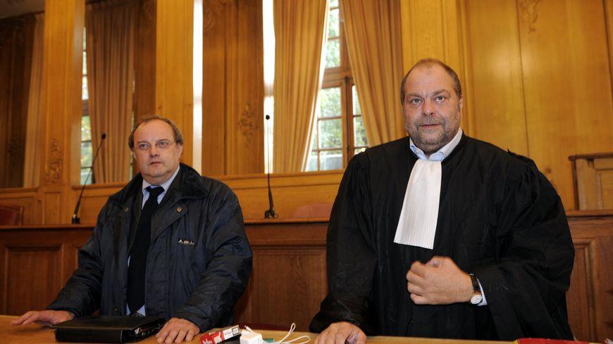 Jean-Louis Muller et son avocat, Eric Dupond-Moretti, lors du troisième procès, à Nancy le 21 octobre 2013.