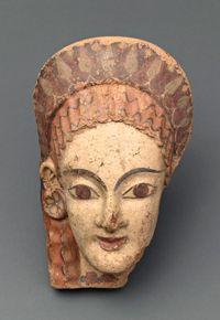 Antéfixe (élément architectural) : tête féminine Fin 6e siècle