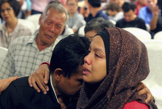 Des proches des victimes de l'avion de la Malaysian