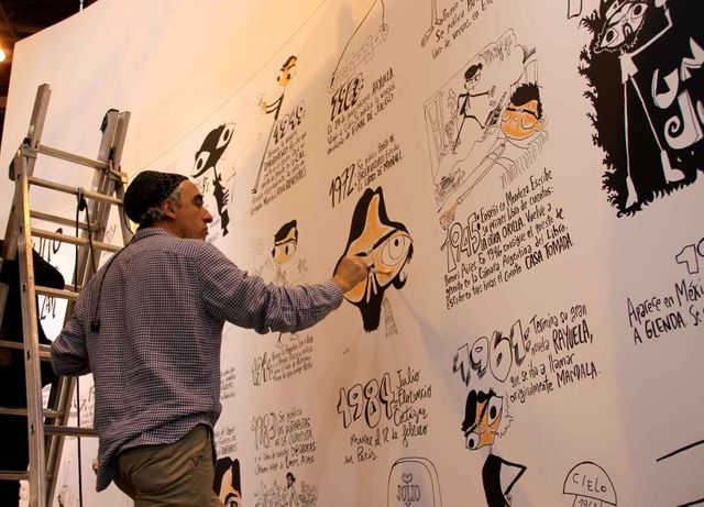 REP en train de peindre la fresque consacrée à Julio Cortazar au Salon du livre