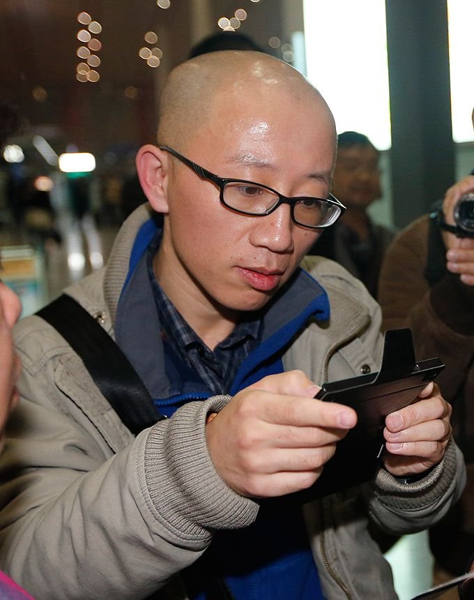 Hu Jia, dissident chinois, le 6 novembre 2013, à l'aéroport de Pékin