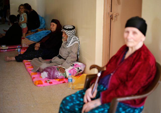 Famille de chrétiens irakiens qui a fui Mossoul pour se réfugier à Erbil
