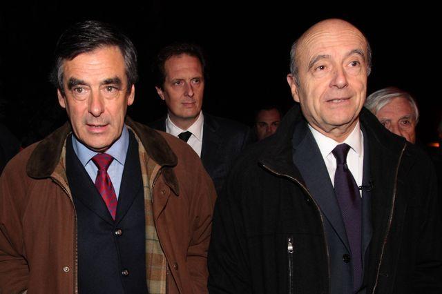 Alain Juppé et François Fillon lors d'un meeting en 2013
