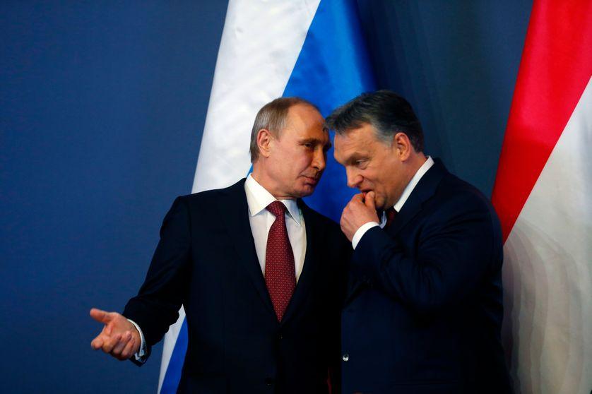 Russian President Vladimir Putin discuss with Hungarian Prime Minister Viktor Orban.