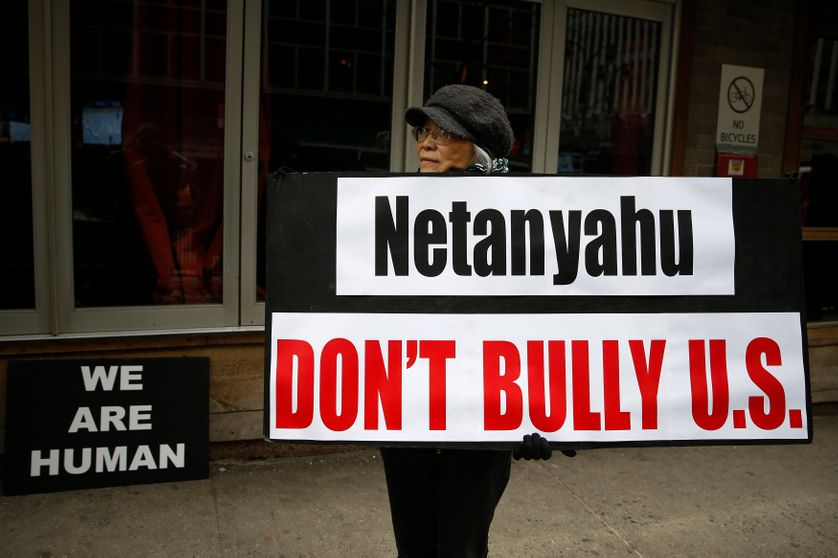 A demonstrator holds a sign during a rally near the Israeli Consulate in New York March 3, 2015.