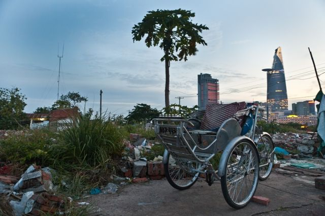Opposite worlds between this cyclo and the Bitexco tower. In Dist 2, HCMC