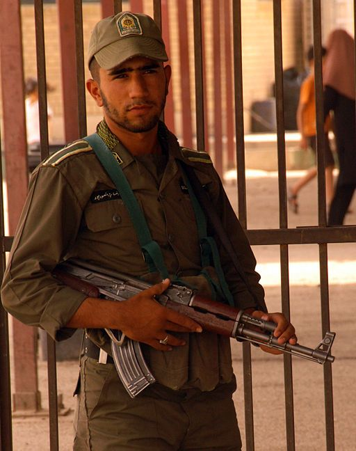 An Iranian soldier stands guard at the gate between Iraq and Iran on the edge of Wasit Province, Iraq, 2008