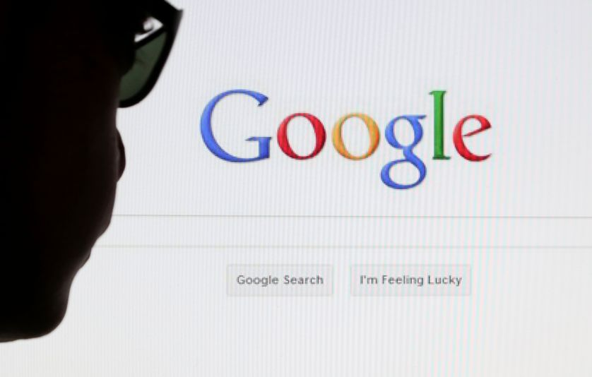 A computer user poses in front of a Google search page.