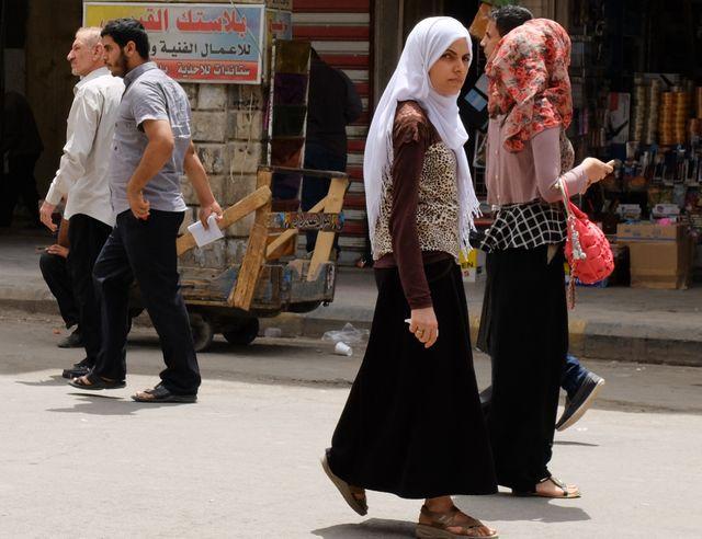 Veuves de guerre dans les rues de Bagdad
