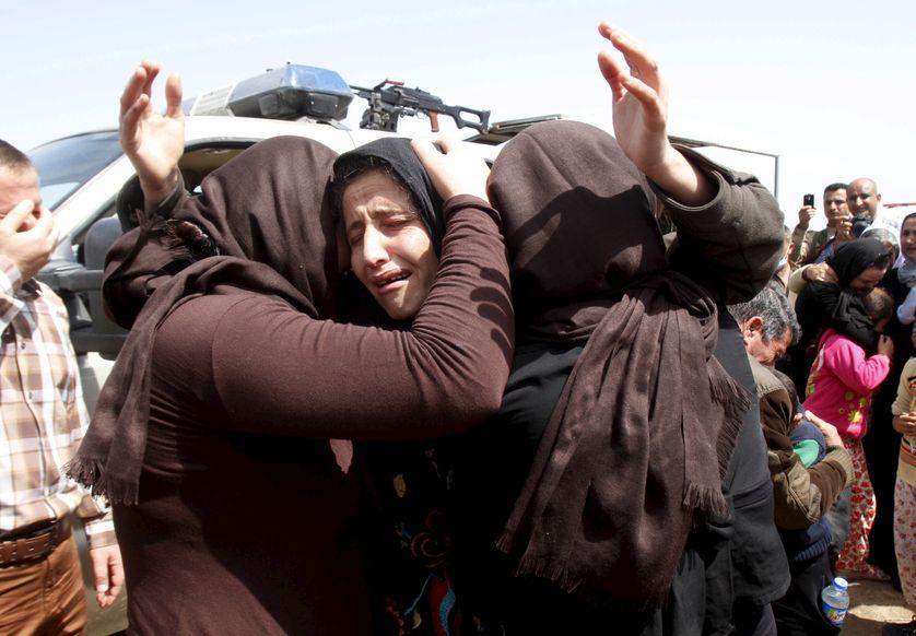 Membres de la minorité Yézidi relâchés par l'Etat islamique qui se retrouvent à Kirkouk, en Irak, le 8 avril 2015