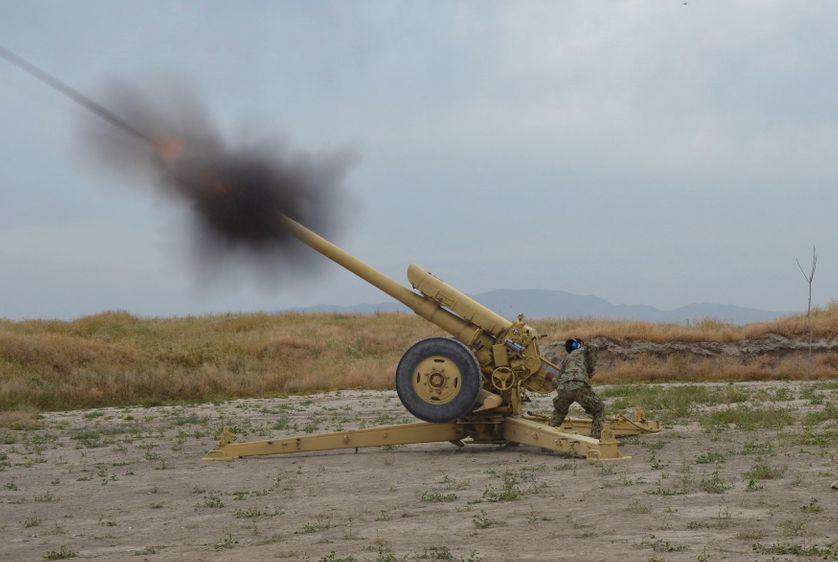 Afghan National Army soldiers fire artillery during a battle with Taliban insurgents in Kunduz, Afghanistan.