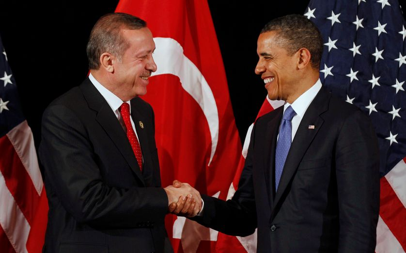U.S. President Barack Obama (R) shakes hands with Turkey's Prime Minister Recep Tayyip Erdogan after a bilateral meeting