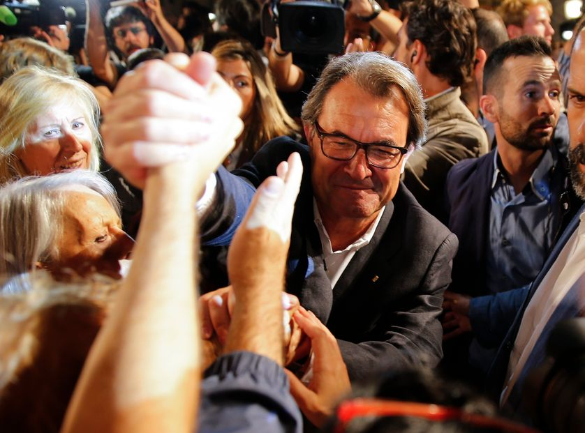 Catalan President Artur Mas greets supporters of Junts Pel Si (Together For Yes) after polls closed in a regional parliamentary