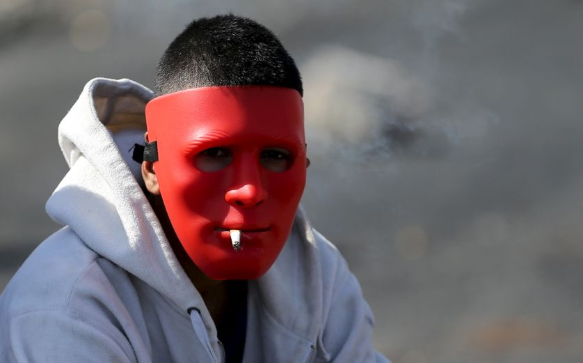 A Palestinian protester during clashes with Israeli troops near the Jewish settlement of Bet El.