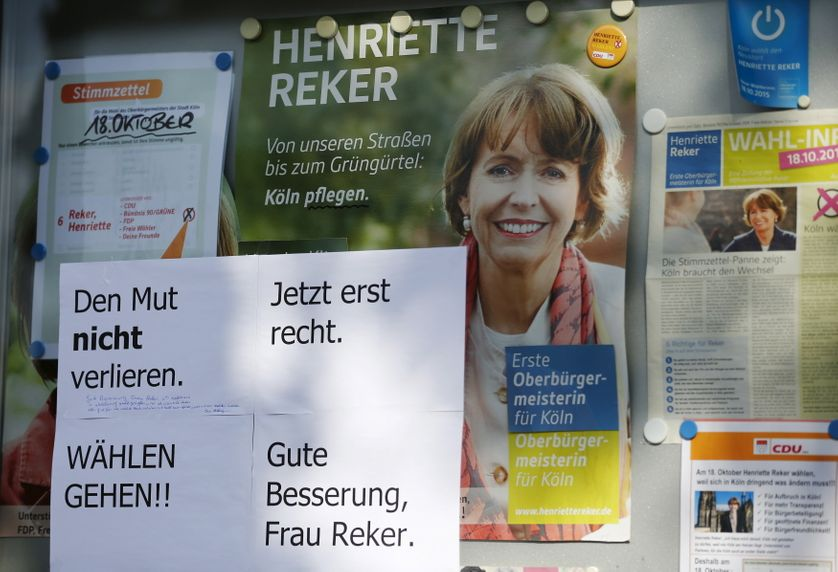 """A paper reads """"Don't loose courage. More than ever. Go Vote !! Get well soon, Miss Reker"""" at an election campaign poster of Henr"""
