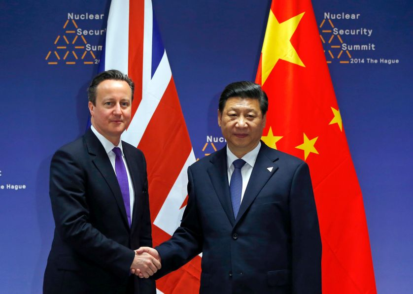 DATE IMPORTED: March 25, 2014 Britain's Prime Minister David Cameron (L) meets with China's President Xi Jinping during the Nucl