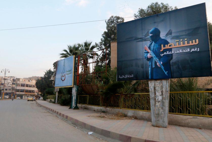 Islamic State billboards are seen along a street in Raqqa.