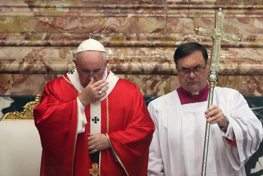 Pope Francis (L) in St. Peter's Basilica at the Vatican.