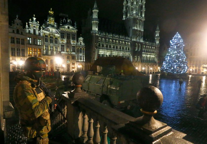 A Belgian soldier stands guard over the Grand Place of Brussels