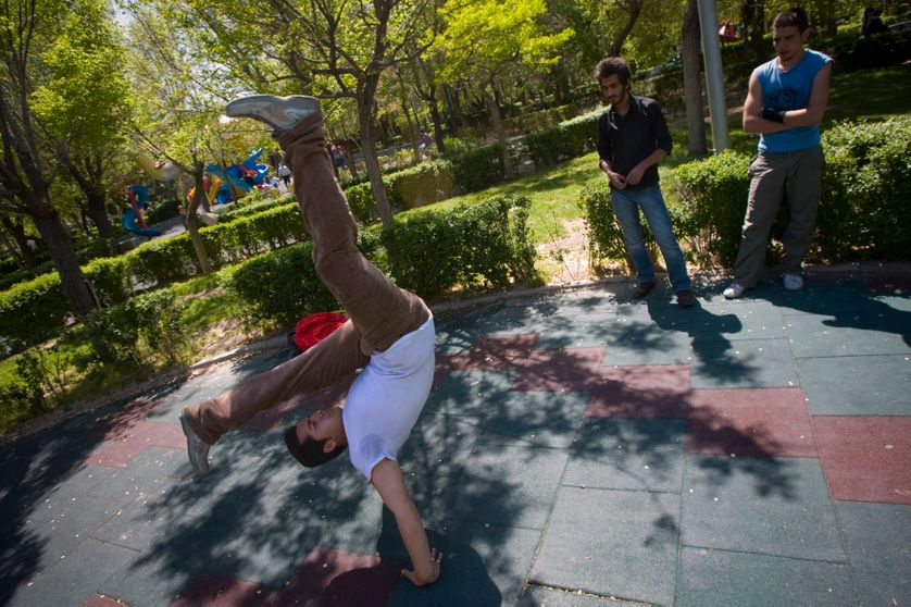 breakdances in a park in Tehran