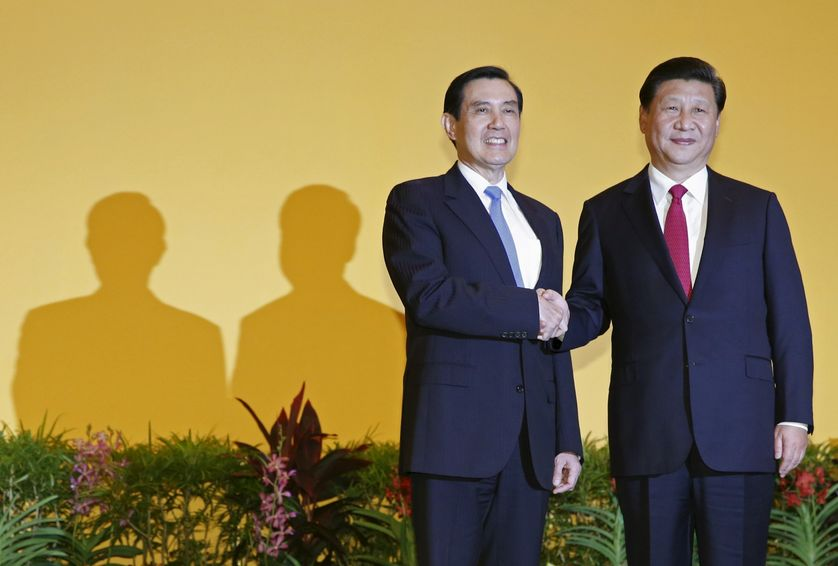 Chinese President Xi Jinping shakes hands with Taiwan's President Ma Ying-jeou.