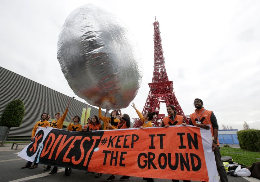 Partisans du désinvestissement en faveur du climat, le 2 décembre 2015, au Bourget, à la COP21
