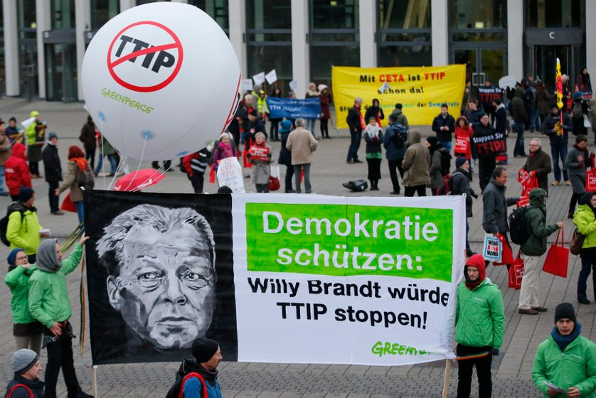 against TTIP outside the Social Democratic Party (SPD) congress in Berlin, Germany, December 11