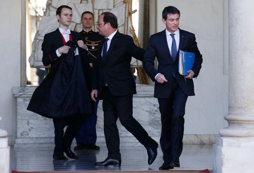 François Hollande et Manuel Valls à la sortie de l'Elysée