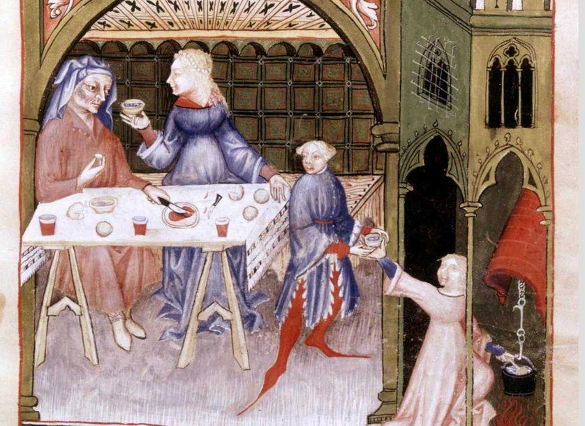 Moyen Age. Scène de repas. Albucacis. XIVe siècle. Conservation BN.