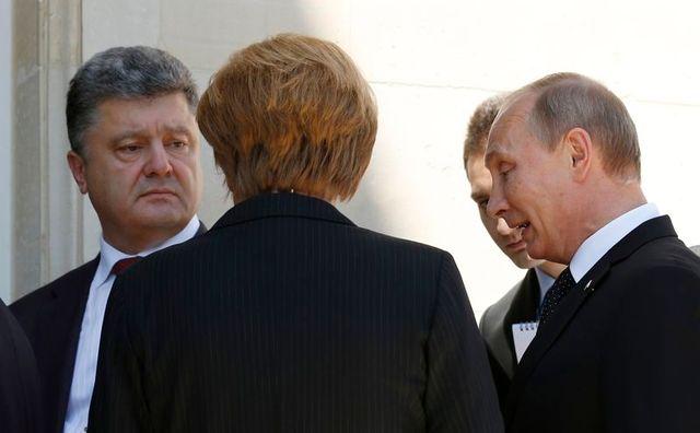 rencontre entre vladimir poutine et petro porochenko en marge des cérémonies du d-day