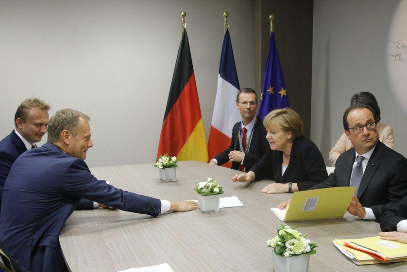 Donald Tusk, Angela Merkel et François Hollande lors d'une réunion d'urgence après le vote grec de rejet des mesures d'austérité proposées par l'Europe