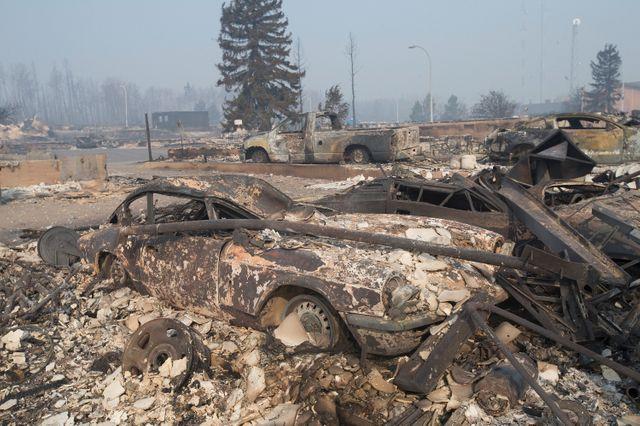Un quartier de Fort McMurray au Canada, détruit par les flammes en mai dernier. 80000 habitants ont dû être évacués.