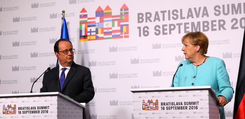 French President Hollande and German Chancellor Merkel attend a joint news conference after the European...