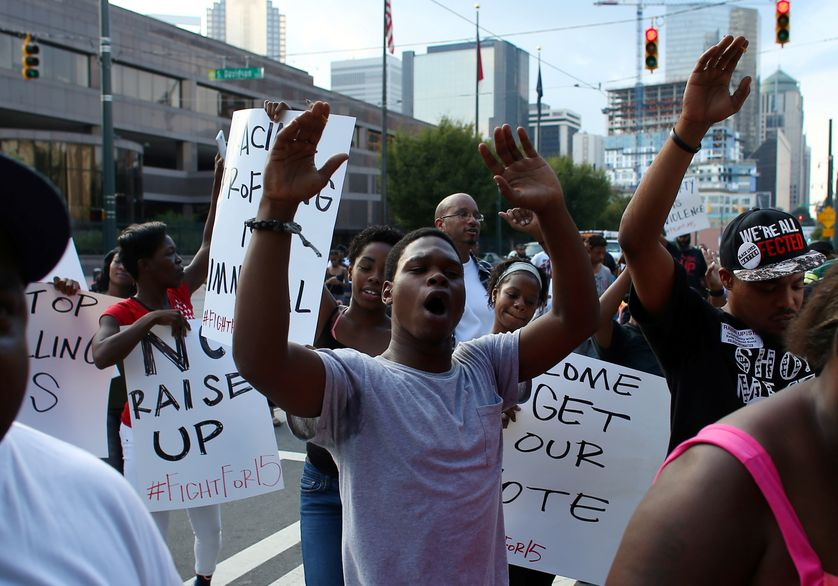 Demonstrators march to protest the police shooting of Keith Scott in Charlotte