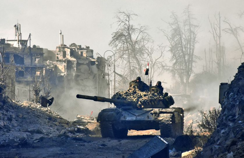 Syrian pro-government forces manoeuver a tank in the newly retaken area of Sahat al-Melh and Qasr al-Adly in Aleppo's Old City on December 8, 2016