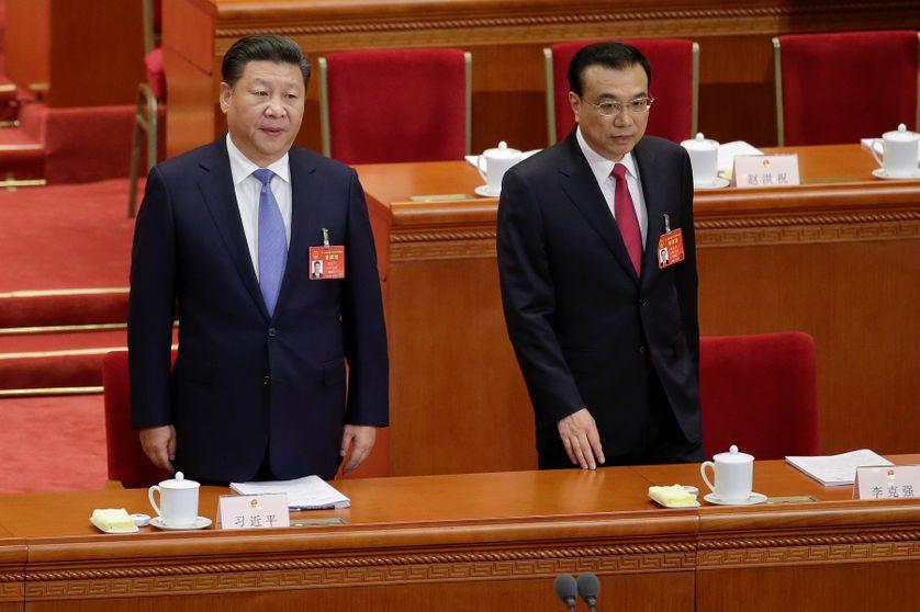 Le président chinois Xi Jinping et le premier ministre Li Keqiang lors de l'ouverture de la session annuelle de l'Assemblée nationale populaire, le 5 mars 2017.