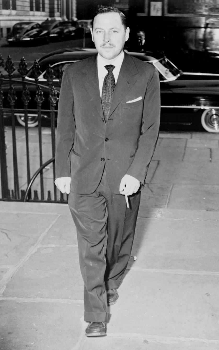 Tennessee Williams, full-length portrait, walking, at service for Dylan Thomas, facing front