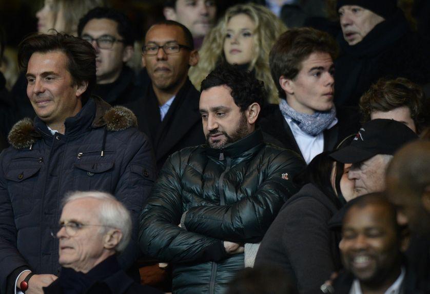 Yannick Bolloré et Cyril Hanouna le 2 mars 2014 assistant à un match de football
