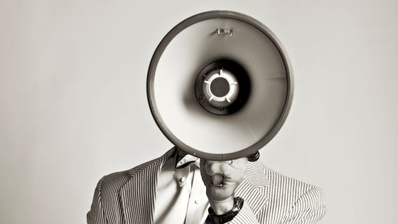USA, Pennsylvania, Mercersburg, Studio portrait of man talking into megaphone