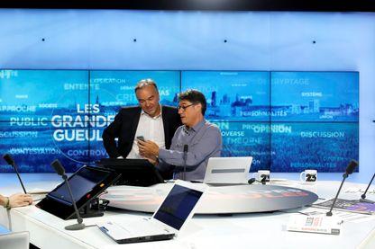 Olivier Truchot et Alain Marschall sur le plateau des Grandes Gueules sur RMC et la chaîne 23 de la TNt en septembre 2016