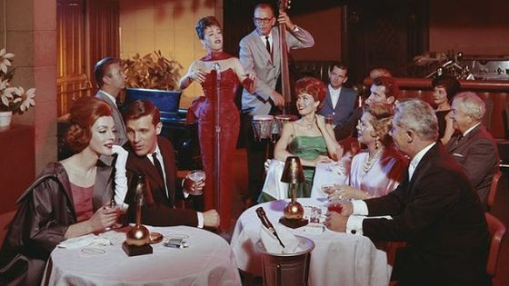 People in restaurant listening musical performance