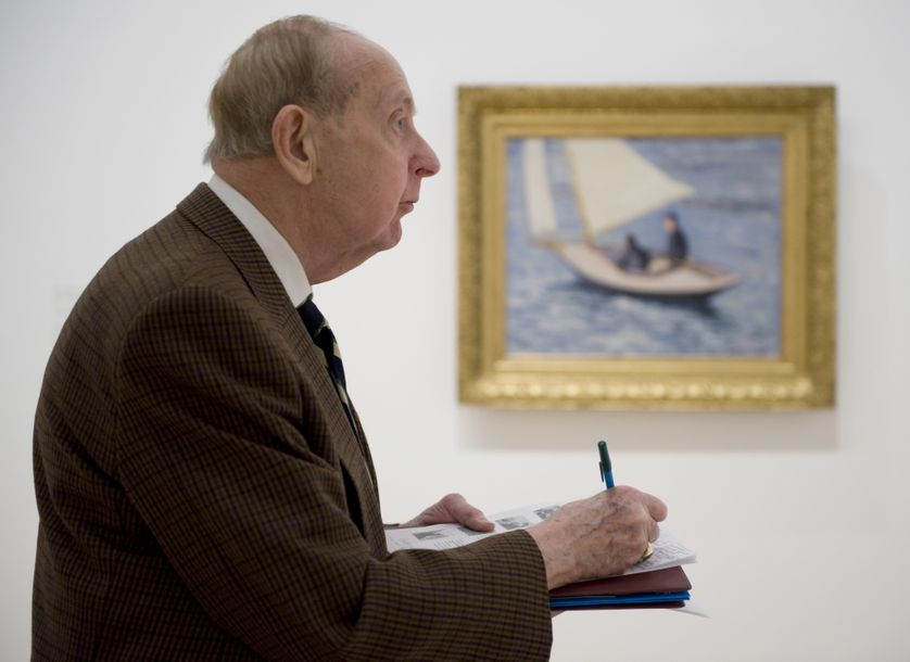 "A reporter views works by French Impressionist Gustave Caillebotte, including ""Sailboat on the River Seine"" on March 26, 2009 at the Brooklyn Museum in New York, part of the ""Impressionist Paintings from Paris to the Sea,"" being shown from March 27-J"