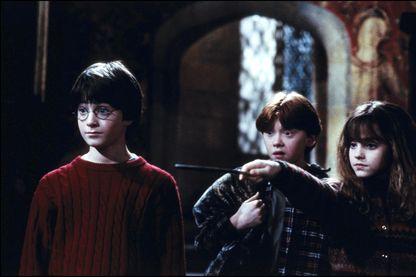 """Harry Potter, Hermione, et Ron dans le film """"Harry Potter à l'école des sorciers"""""""