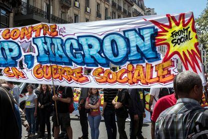 Le 14 Juillet 2017 Manifestation du Collectif Front Social contre la reforme du droit du travail dans la marche de protestation contre Trump et Macron.