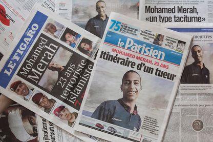 Une photo d'illustration montre les journaux nationaux français affichant, le 22 mars 2012, les premières photos de Mohammed Merah.