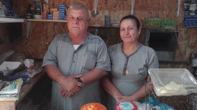 Des commerçants chrétiens dans le camp de réfugiés d'Ankawa, près d'Erbil. leur maisona  été incendiée et ils nb'ont plus de quoi reconstruire